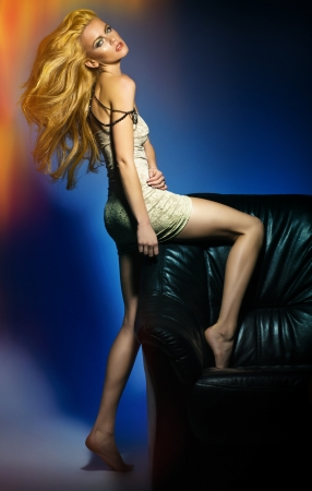 Sexy young woman posing on the sofa Stock Photo - 16304822