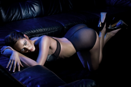Sexy brunette in the black scenery Stock Photo - 16304819