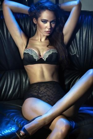 Voluptuous brunette on the sofa Stock Photo - 16304833