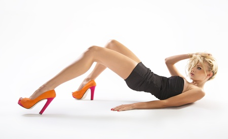 Young lady wearing orange high-heels Stock Photo - 16304815