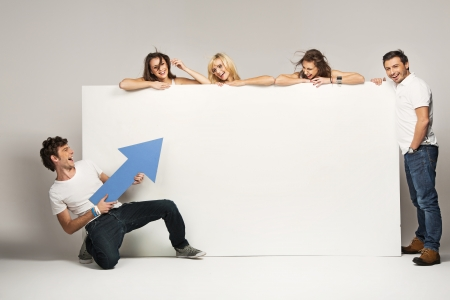 blank poster: Young people with an empty white board Stock Photo