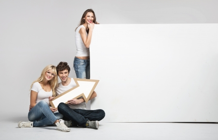 advertising board: Handsome man with two young girls and arrow Stock Photo