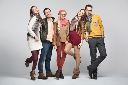 friends happy: Fashion style picture of  young group of friends Stock Photo