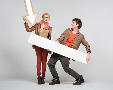 Fantastic young couple playing the signs Stock Photo - 16573634