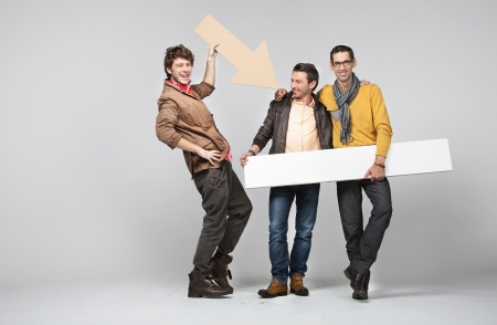 room mate: A band of male young friends with signs Stock Photo