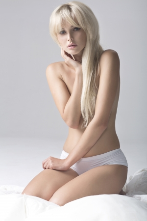 nude in bed: Portrait of Fresh and Beautiful blonde girl on bed