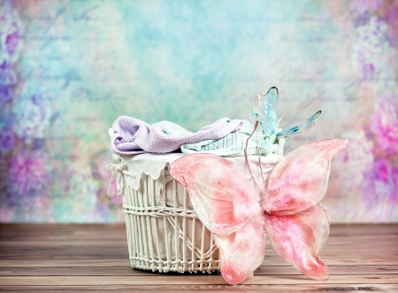 Small wicker basket with marvelous colorful background photo