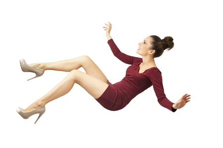 Young attractive lady falling down photo