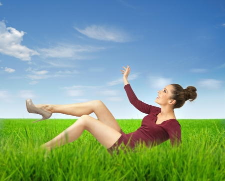 Attractive brunette lady lying on grass Stock Photo - 16573592