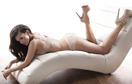 woman lingerie: Sexy lady wearing cream-coloured lingerie Stock Photo