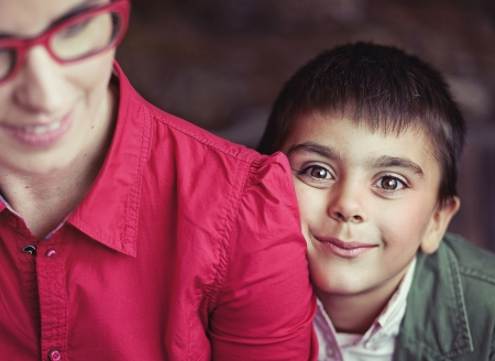Cute boy with big brown eyes hugging his mom Stock Photo - 17014681