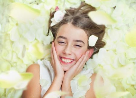 Cheerful small girl in petal's bath Stock Photo - 17049454