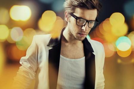 BLACK GLASS: Sam man wearing big fashionable glasses Stock Photo
