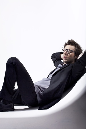 Very attractive man relaxing in his place photo