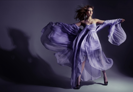 dress blowing in the wind: Fine shoot of an attractive brunette lady wearing amazing dress