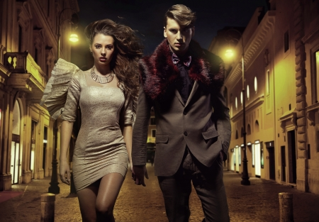 men hair style: An attractive young couple walking downtown Stock Photo