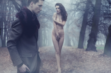 nude fashion model: Fashion male model and nude young woman Stock Photo