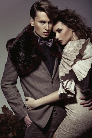 Young attractive couple presenting an autumn fashion photo