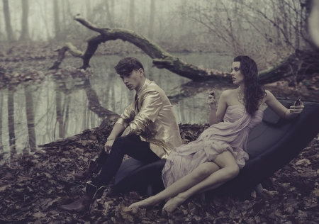 Sexy young couple over nature background