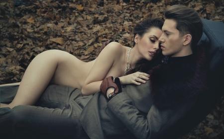 Nude sensual woman hugging young man photo