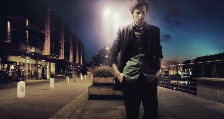 stylish men: Sad handsome man walking alone at the night Stock Photo