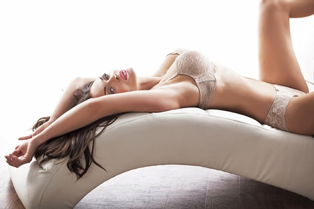 bra model: Slim young woman wearing sensual lingerie in sexy pose Stock Photo