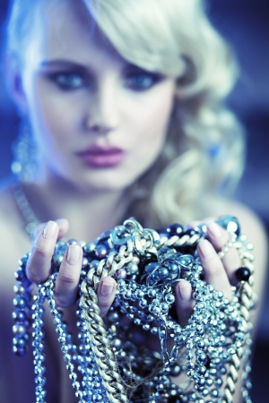Amazing blonde woman with various jewelary photo