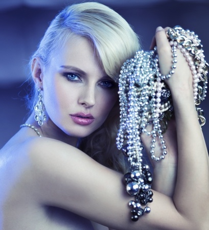 Fabulous blonde woman with bouquet of jewelary photo