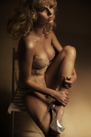 hand bra: Delicate blonde beautiful girl wearing lingerie