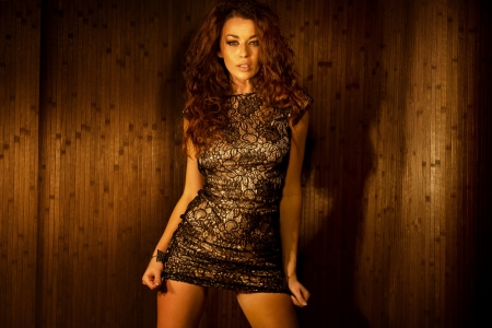 alluring: Alluring brunette young woman wearing sensual clothes Stock Photo