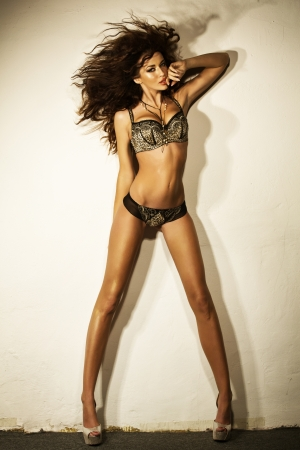 long legs: Young sexy lady with perfect body Stock Photo