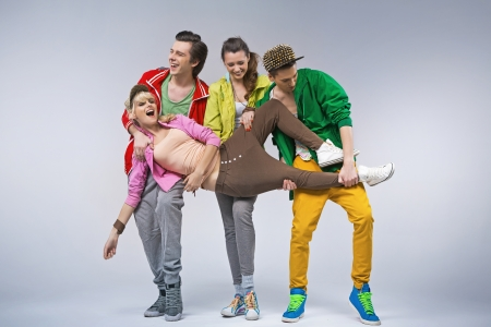 Hip-hop teenagers making funny poses during spare time Standard-Bild
