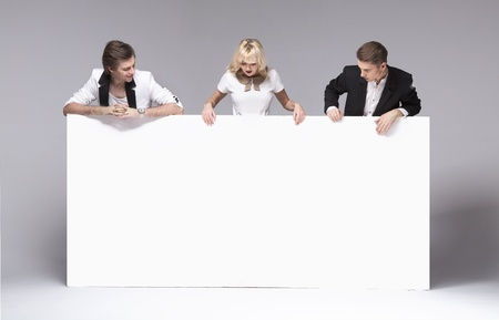fashion clothing: Small group of friends having fun with empty white board Stock Photo