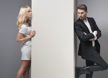 elegant business man: Alluring blonde girl trying to catch her boyfriend