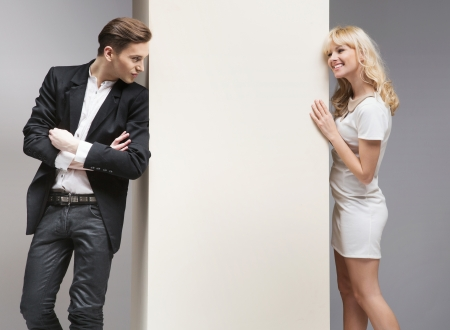 fashion  woman: Soft flirt between attractive young couple Stock Photo