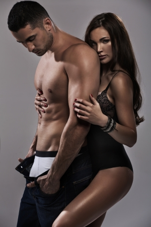 Marvelous brunette woman feeling safe with her man photo