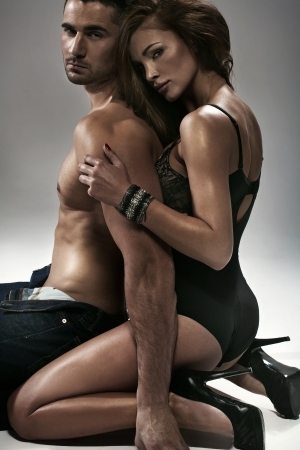 sensuality: Sexy woman hugging her athletic husband