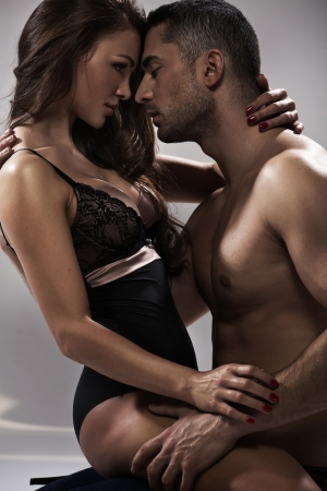 Sensual pose of an attractive young couple photo