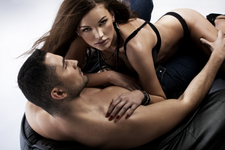 Great shot of sensual woman with her muscular boyfriend photo