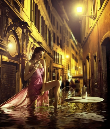 Pretty young woman taking urban bath photo