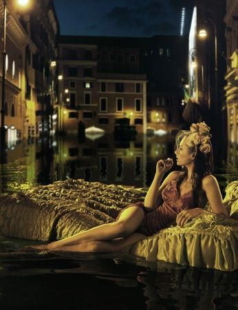 Alone woman watching flooded city photo