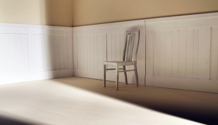 Bright interior with old chair against wall photo