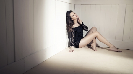 long legs: Young beauty brunette woman over white wall Stock Photo