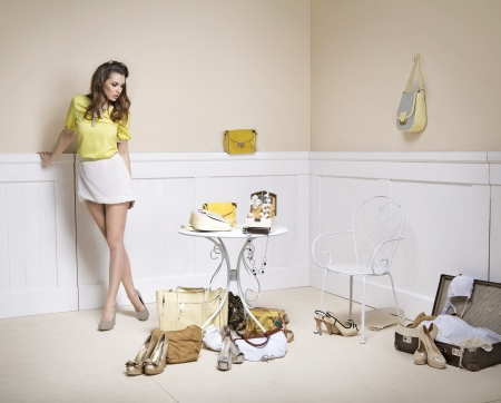 elegance fashion girls look sensuality young: Elegant woman in a room full of fashion accessories