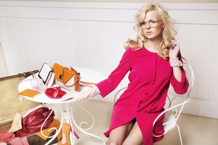 Stylish blonde woman in room full off fashion elements Stock Photo - 18878753