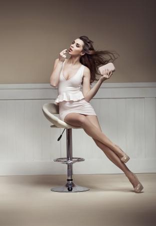 pose sensual: Marvelous woman doing light make-up Stock Photo