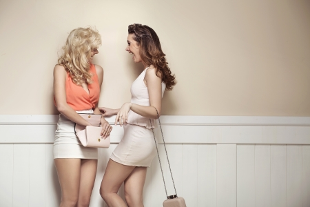 alluring: Laughing alluring girlfriends with sexy long legs