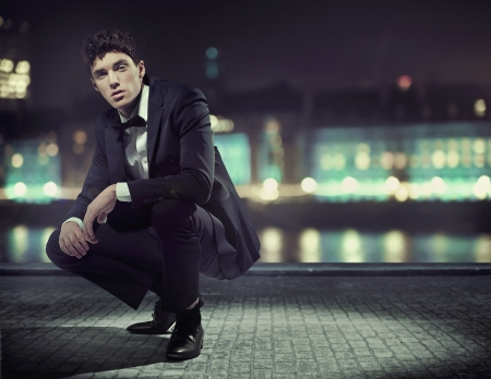 man jump: Handsome young guy with great tuxedo Stock Photo