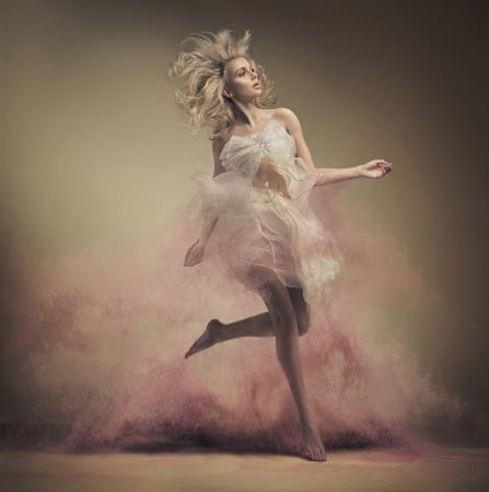 woman fashion: Dynamic photo of a stunning blonde lady Stock Photo