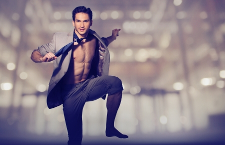 Handsome muscular guy in loose suit Stock Photo - 19566427
